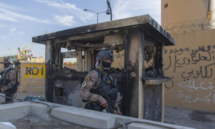 Iraqi army soldiers are deployed in front of the U.S. embassy, in Baghdad, Iraq, on Jan. 1, 2020. (Nasser Nasser/AP Photo)