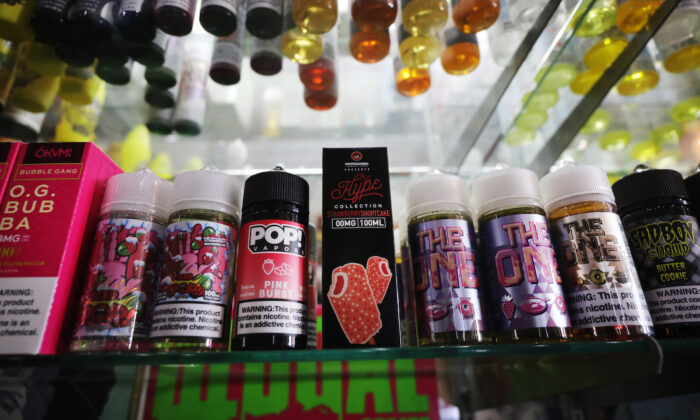Vaping products, including flavored vape liquids and pods, are displayed at Gotham Vape in New York City on Sept. 17, 2019. (Spencer Platt/Getty Images)
