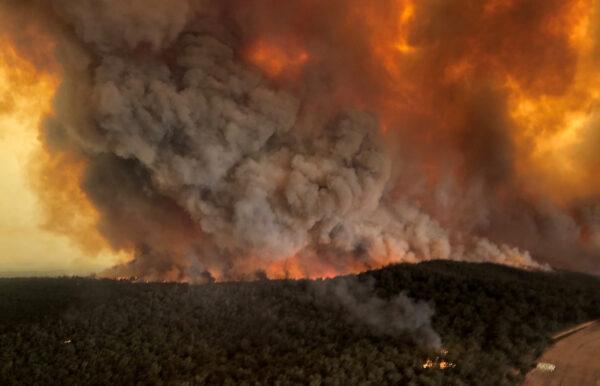 Smoke billows during bushfires in Bairnsdale