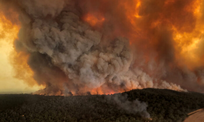 Smoke billows during bushfires in Bairnsdale, a city in East Gippsland, Victoria, Australia, Dec. 30, 2019. (Glen Morey/Social Media/via Reuters)