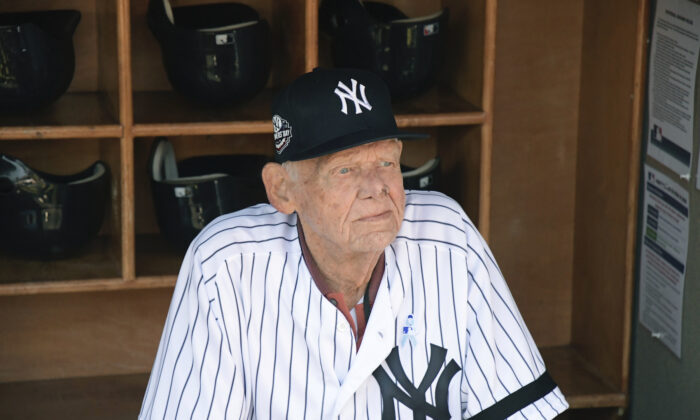 New York Yankees' Don Larsen sits in the dugout before the Yankees' Old-Timers' Day baseball game at Yankee Stadium in New York on June 17, 2018. (AP Photo/Bill Kostroun, File)