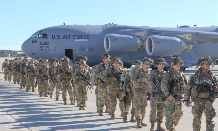 U.S. Army Paratroopers assigned to the 2nd Battalion, 504th Parachute Infantry Regiment, 1st Brigade Combat Team, 82nd Airborne Division, deploy from Pope Army Airfield, N.C., on Jan. 1, 2020. Additional troops from the brigade are deploying, the Department of Defense said on Jan. 3, 2019. (Capt. Robyn Haake/US ARMY/AFP via Getty Images)
