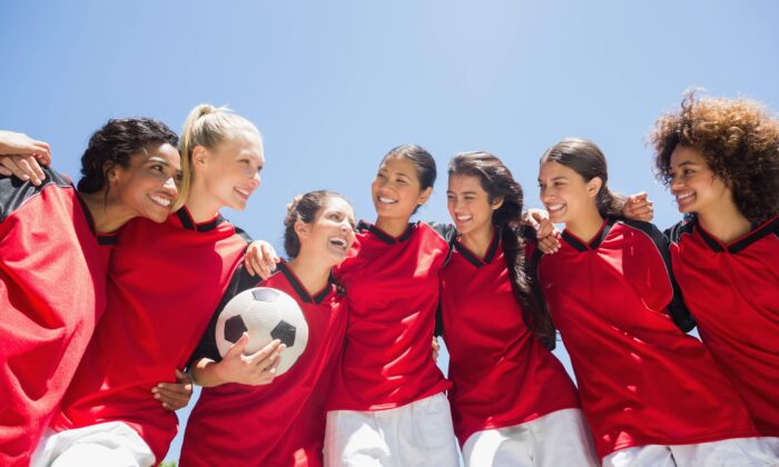 Participating in a team sport offers a mental health boost over solitary exercise—if you're into the game. (wavebreakmedia/Shutterstock)
