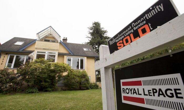 A real estate sign outside a home in Vancouver on June 12, 2018. Housing assessments in British Columbia show the real estate market continues to see signs of moderation in the Lower Mainland while stabilizing on Vancouver Island and other parts of the province. (The Canadian Press/Jonathan Hayward)