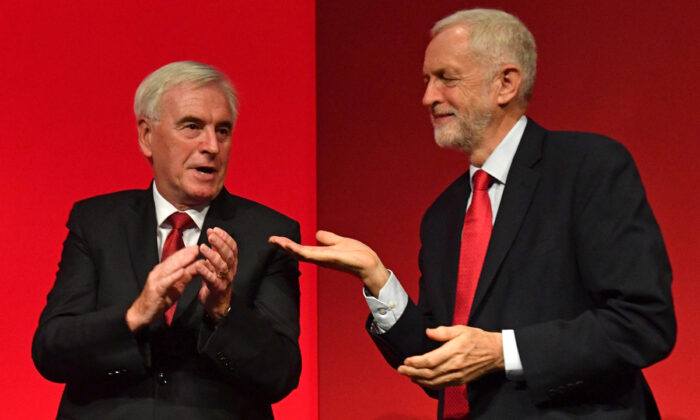 Britain's Labour Party Leader Jeremy Corbyn (R) gestures to Labour party's shadow Chancellor John McDonnell (L) on stage after McDonnell's speech during the Labour party conference in Brighton, England, on Sept. 23, 2019.  Daniel Leal-Olivas/AFP via Getty Images