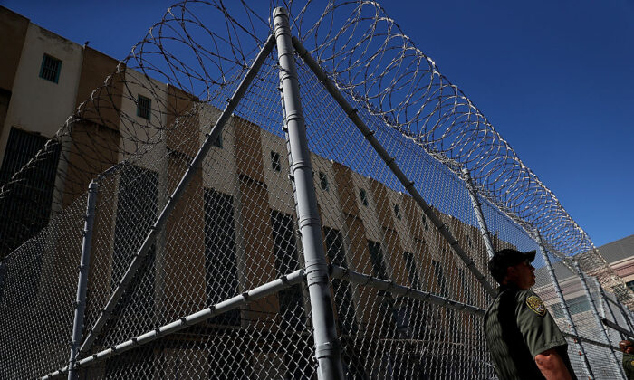 An armed California Department of Corrections and Rehabilitation (CDCR) officer stands guard at San Quentin State Prison on Aug. 15, 2016. (Justin Sullivan/Getty Images)
