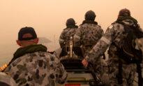 Australian Navy Begins Mass Evacuations as New Fire Threat Looms
