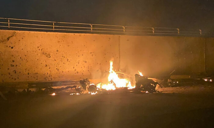 A burning vehicle at the Baghdad International Airport following an airstrike, in Baghdad, Iraq, early Jan. 3, 2020. (Iraqi Prime Minister Press Office via AP)