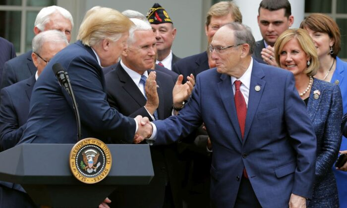 President Donald Trump (L) shakes hands with Rep. Phil Roe (R-Tenn.). (Chip Somodevilla/Getty Images)
