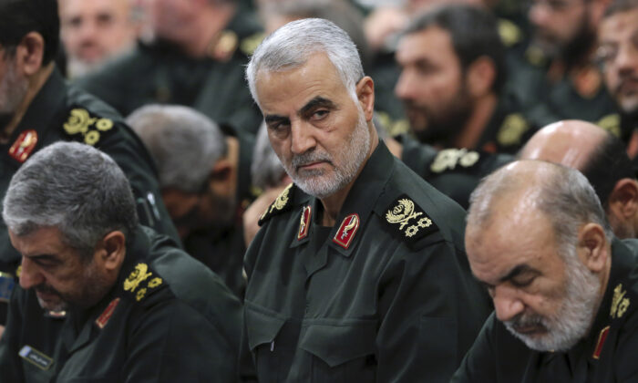 Revolutionary Guard Gen. Qassem Soleimani (C) attends a meeting in Tehran, Iran, on Sept. 18, 2016.  Office of the Iranian Supreme Leader via AP