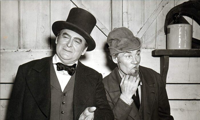 "Edward Arnold (L) as Daniel Webster and John Huston as Mr. Scratch in the 1941 film ""The Devil and Daniel Webster,"" originally titled  ""All That Money Can Buy."" (RKO Radio Productions)"