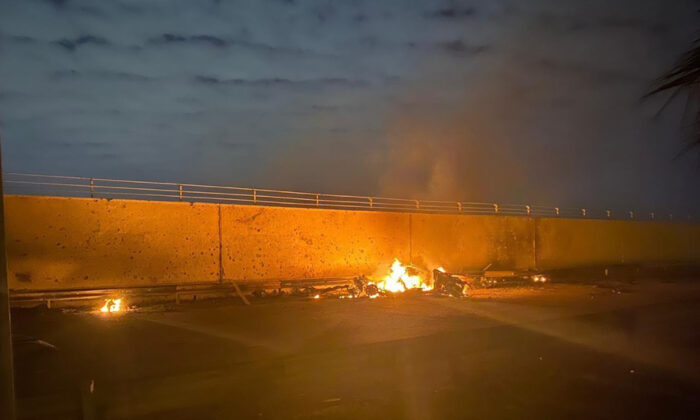 A burning vehicle at the Baghdad International Airport following an airstrike, in Baghdad, Iraq, early Friday, Jan. 3, 2020. (Iraqi Prime Minister Press Office via AP)