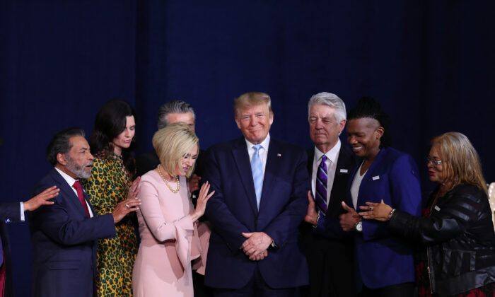 Evangelical leaders gather on stage with President Donald Trump during an Evangelicals for Trump campaign event held at the King Jesus International Ministry in Miami, Florida on Jan. 3, 2020. (Joe Raedle/Getty Images)
