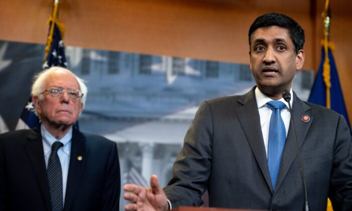 Rep. Ro Khanna (D-Calif.) (R) and Sen. Bernie Sanders (I-Vt.) at a press conference in Washington in an April 2019 file photograph. (Saul Loeb/AFP via Getty Images)