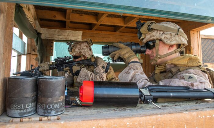 U.S. Marines with 2nd Battalion, 7th Marines, assigned to the Special Purpose Marine Air-Ground Task Force-Crisis Response-Central Command (SPMAGTF-CR-CC) 19.2, provide security at the U.S. embassy compound in Baghdad, Iraq, on Jan. 3, 2020. (U.S. Marine Corps/Sgt. Kyle C. Talbot/Handout via Reuters)