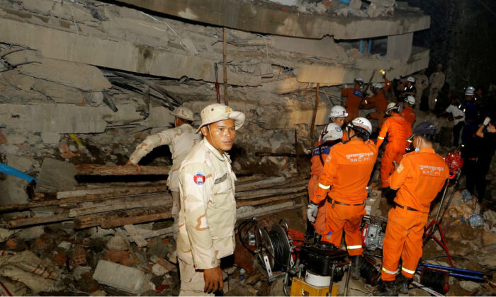 A rescue team searches for trapped workers in a collapsed building which was under construction in Kep, Cambodia, on Jan. 3, 2020. (Stringer/Reuters)