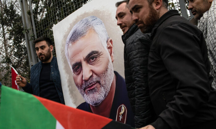 People hold posters showing the portrait of Iranian Revolutionary Guard Maj. Gen. Qassem Soleimani during a protest outside the U.S. Consulate in Istanbul, Turkey, on Jan. 5, 2020. (Chris McGrath/Getty Images)