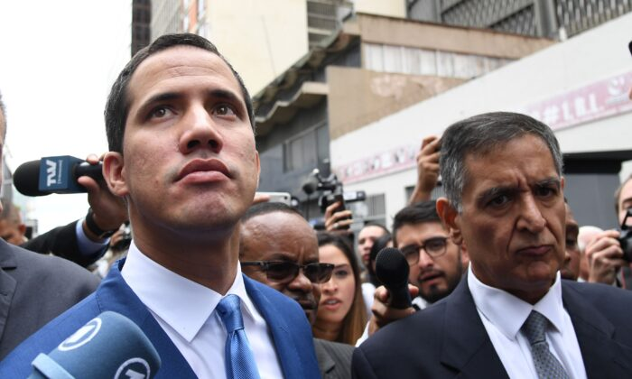 Venezuelan opposition leader Juan Guaido, who many nations have recognized as the country's rightful interim ruler, arrives at the National Assembly in Caracas, where he is due to be voted in for a second term as parliament speaker, on Jan. 5, 2020. (Yuri Cortez/AFP via Getty Images)
