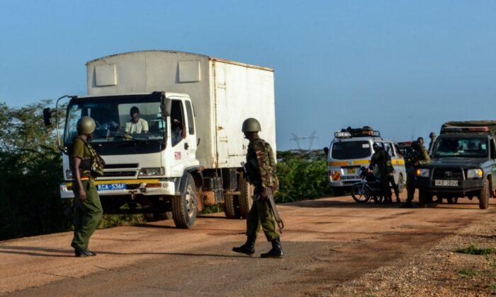 Kenyan police officers checking vehicles after an ambush by gunmen in Lamu county, Kenya, on Jan. 2, 2020. (Stringer/AFP/Getty Images)