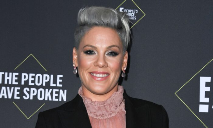 US singer/songwriter Pink poses with the Peoples Champion Award during the 45th annual E! People's Choice Awards at Barker Hangar in Santa Monica, California, on Nov. 10, 2019. (VALERIE MACON/AFP via Getty Images)