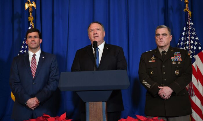 Secretary of State Mike Pompeo (C), Secretary of Defense Mark Esper (L) and Chairman of the Joint Chiefs of Staff US army general Mark A. Milley (R) speak on stage during a briefing on the past 72 hours events in Mar a Lago, Palm Beach, Fla., on Dec. 29, 2019. (Nicholas Kamm/AFP via Getty Images)