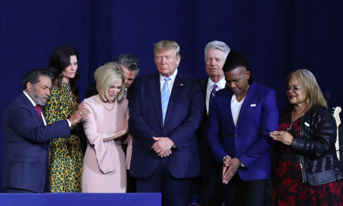Faith leaders pray over President Donald Trump during a 'Evangelicals for Trump' campaign event held at the King Jesus International Ministry in Miami, Fla., on Jan. 3, 2020. (Joe Raedle/Getty Images)
