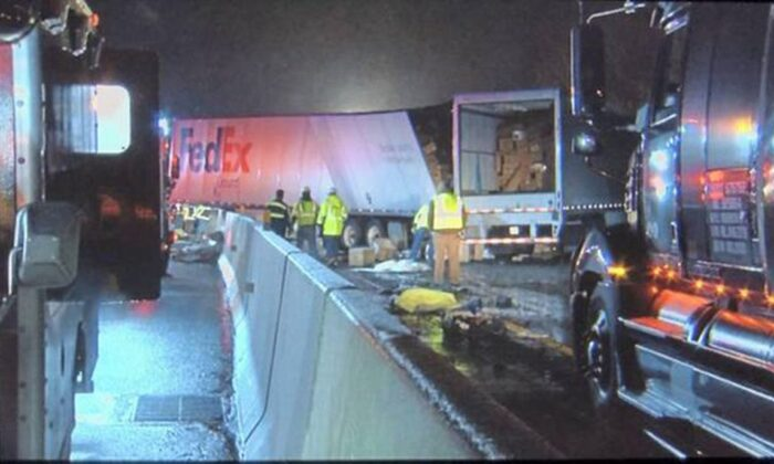 Emergency crews respond to a fatal crash on the Pennsylvania Turnpike in Mount Pleasant Township early Sunday morning, Jan. 5, 2020. Multiple people were killed early Sunday in a crash involving a passenger bus, two tractor-trailers and passenger vehicles in Pennsylvania, officials said. (WPIX TV via AP)