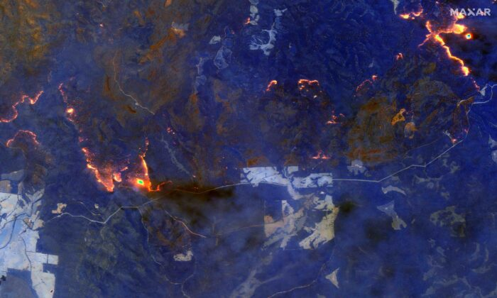 A shortwave infrared image shows wildfires burning east of Obrost, Victoria, Australia on Jan. 4, 2020. (Satellite image ©2020 Maxar Technologies/Handout via REUTERS)