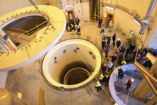 In this photo released by the Atomic Energy Organization of Iran, technicians work at the Arak heavy water reactor's secondary circuit, as officials and media visit the site, near Arak, 150 miles (250 kilometers) southwest of the capital Tehran, Iran, Monday, Dec. 23, 2019. (Atomic Energy Organization of Iran via AP)