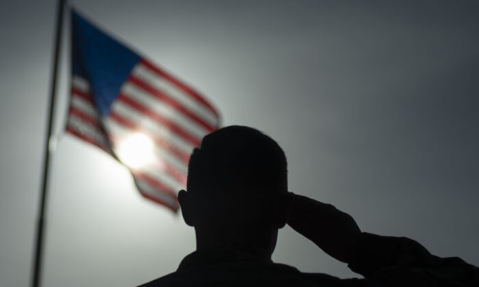 A soldier saluting the American flag. (Staff Sgt. Lexie West/U.S. Air Force via AP)