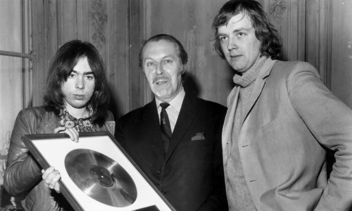 "British composer Andrew Lloyd Webber (L) and lyricist Tim Rice (R) are presented with the Gold and Platinum discs for their hit musical ""Jesus Christ Superstar"" in December 1971. Jesus has been appropriated by the adherents of practically every progressive movement—socialism, pacifism, liberation theology, feminism, free love, flower power, Black Power, Occupy Wall Street—of the past two centuries. (Evening Standard/Getty Images)"