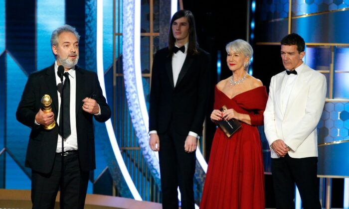 """Filmmaker Sam Mendes (L) accepts the award for Best Director - Motion Picture for """"1917,"""" at the 77th Golden Globe Awards Show in Beverly Hills, Calif., on Jan. 5, 2020. (Paul Drinkwater/NBC Universal/Handout via Reuters)"""