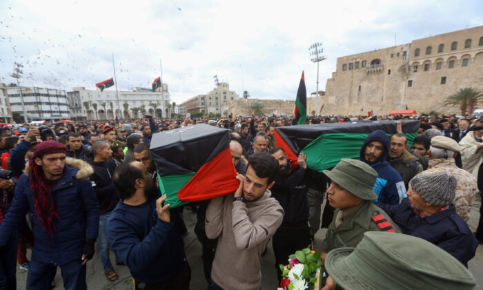 Libyan mourners carry the coffin of army cadets who were killed in an airstrike on a military school, during their funeral in the Martyrs Square of Libya's capital Tripoli on Jan. 5, 2020. (Mahmud Turkia/AFP via Getty Images)