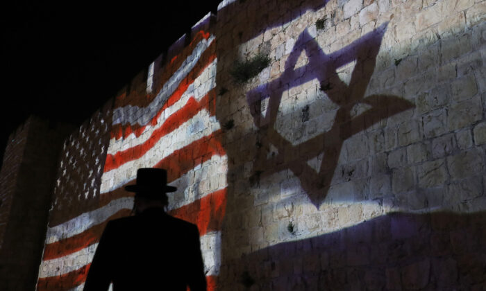 The Israeli and United States flags are projected on the walls of the ramparts of Jerusalem's Old City to mark one year since the transfer of the US Embassy from Tel Aviv to Jerusalem on May 15, 2019. (Ahmad Gharabli/AFP via Getty Images)