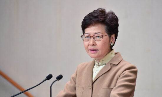 Hong Kong Leader Lam Commits to Working Closely With New Beijing Envoy