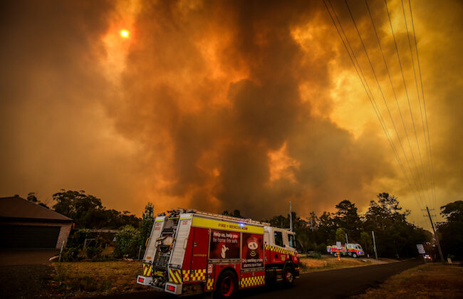 Firemen prepare as a bushfire approaches homes on the outskirts of the town of Bargo on December 21, 2019 in Sydney, Australia. (David Gray/Getty Images)