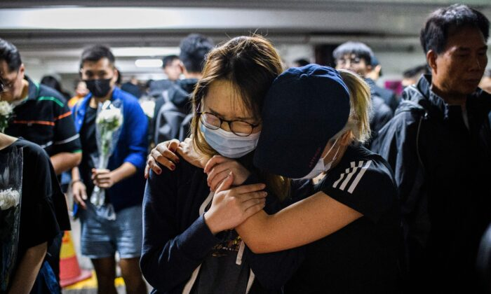 Mourner pay their respects at the car park where student Alex Chow, 22, fell during a protest in Hong Kong on Nov. 8, 2019. (Anthony Wallace/AFP via Getty Images)