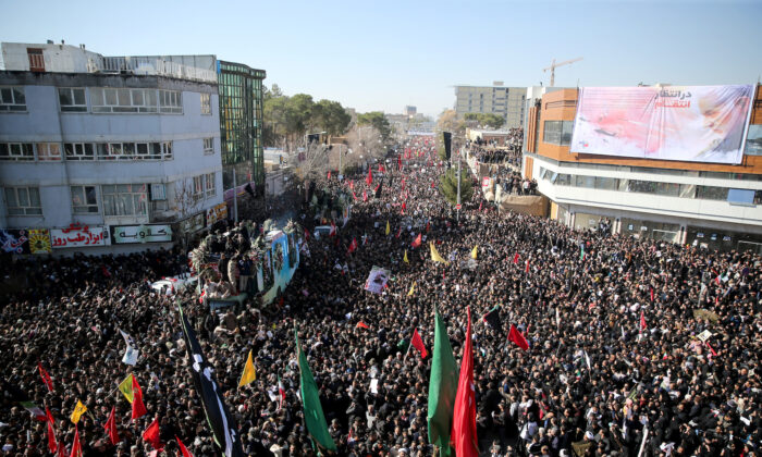 Iranian people attend a funeral procession and burial for Iranian Major-General Qassem Soleimani, head of the elite Quds Force, who was killed in an air strike at Baghdad airport, at his hometown in Kerman, Iran on Jan. 7, 2020. (Mehdi Bolourian/Fars News Agency/WANA/West Asia News Agency via Reuters)