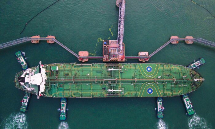 This aerial photo taken on Aug. 4, 2019 shows tugboats berthing an oil tanker at Qingdao port in Qingdao in China's eastern Shandong Province. (STR/AFP via Getty Images)
