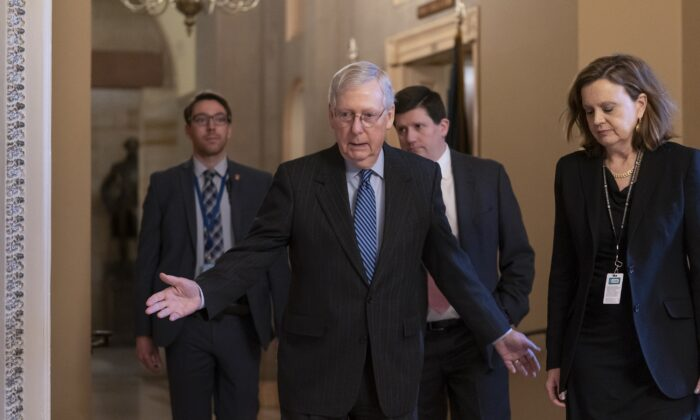Senate Majority Leader Mitch McConnell (R-Ky.) arrives for a closed meeting with fellow Republicans as he strategizes about the looming impeachment trial of President Donald Trump, at the Capitol in Washington on Jan. 7, 2020. (J. Scott Applewhite/AP Photo)