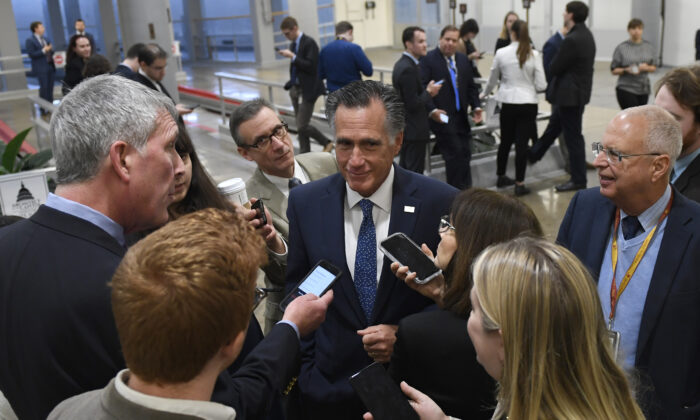 Sen. Mitt Romney (R-Utah) talks to reporters on Capitol Hill in Washington on Dec. 17, 2019. (Susan Walsh/AP Photo)