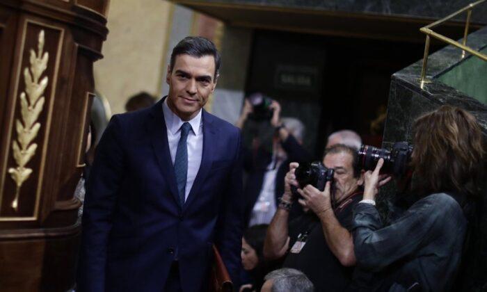 Spain's caretaker Prime Minister Pedro Sanchez arrives at the Spanish Parliament in Madrid, Spain, Sunday, Jan. 5, 2020. (AP Photo/Manu Fernandez)
