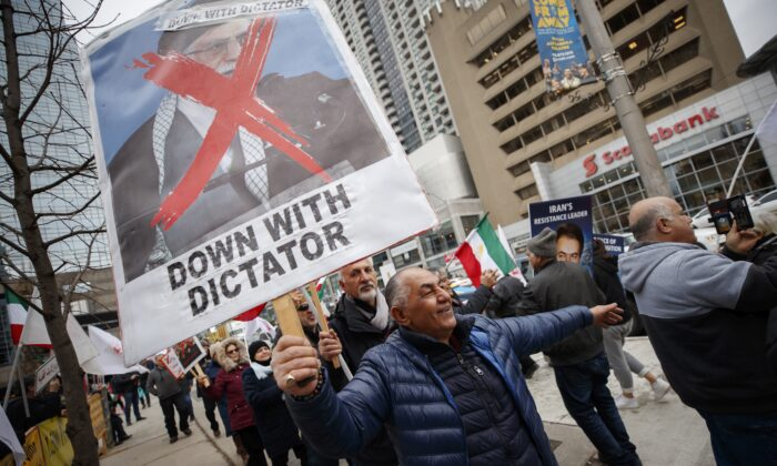 Iranian-Canadians gather in Toronto on Jan. 3, 2020, to celebrate the death of Gen. Qasem Soleimani in Iraq on Jan. 2. The killing has sparked renewed calls to designate the Islamic Revolutionary Guard Corps as a terrorist organization. (The Canadian Press/Cole Burston)