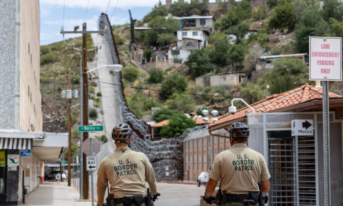 Border Patrol agents patrol the border in Nogales, Ariz., on July 29, 2019. The city of Nogales, Mexico, abuts the border fence to the right. (CBP)