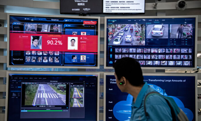 A display for facial recognition and artificial intelligence is seen on monitors at Huawei's Bantian campus in Shenzhen, China, on April 26, 2019. (Kevin Frayer/Getty Images)