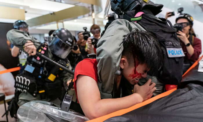 A man is detained by riot police during a demonstration in a shopping mall in Hong Kong on Dec. 28, 2019.(Photo by Anthony Kwan/Getty Images)