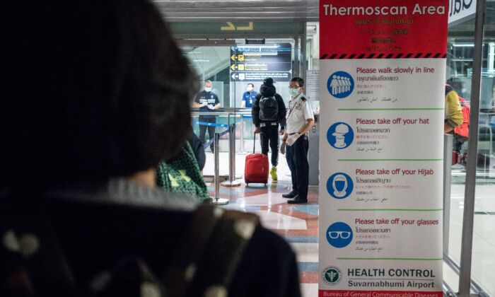 Thailand Public Health Officials run thermal scans on passengers arriving from Wuhan, China at Suvarnabumi Airport in Bangkok, Thailand on Jan. 8, 2020. (Lauren DeCicca/Getty Images)
