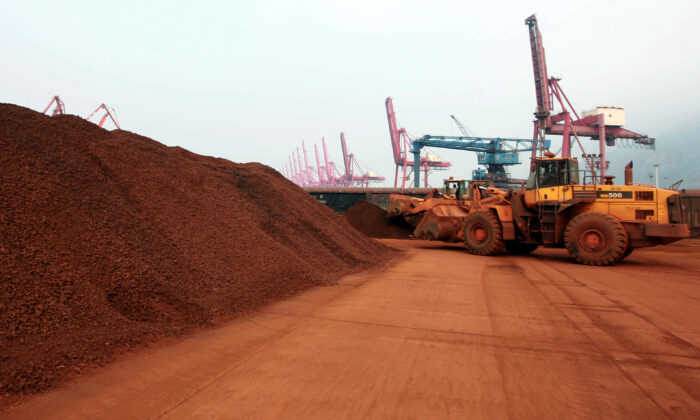 A loader shifts soil containing rare earth minerals to be loaded at a port in Lianyungang, in China's Jiangsu province, for export to Japan. China controls the world's supply of rare earth minerals and the United States is seeking partnerships with allies to reduce its dependence on China. (STR/AFP via Getty Images)