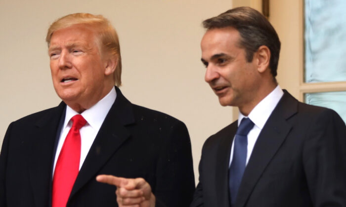 President Donald Trump poses for photos with Prime Minister of Greece Kyriakos Mitsotakis at the West Wing colonnade of the White House on Jan. 7, 2020. (Alex Wong/Getty Images)