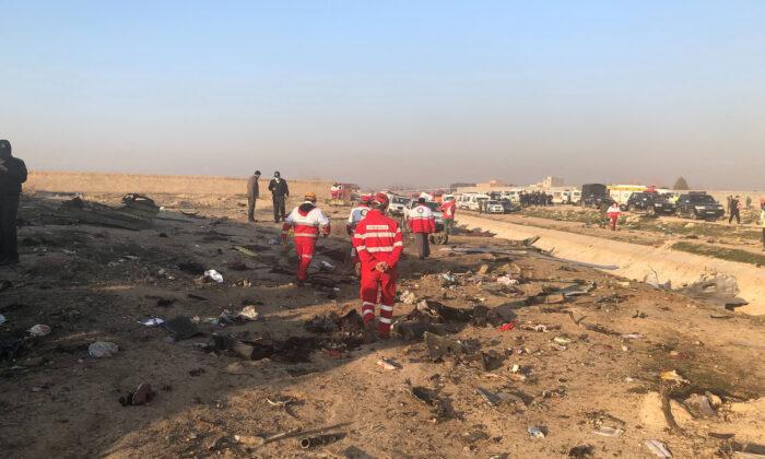 Debris is seen from a plane crash on the outskirts of Tehran, Iran, Wednesday, Jan. 8, 2020. (AP Photos/Mohammad Nasiri)